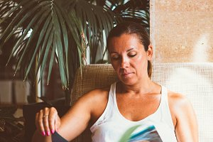 Attractive woman reading magazine