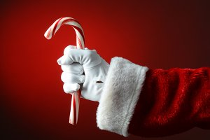 Santa Claus Holding Large Candy Cane