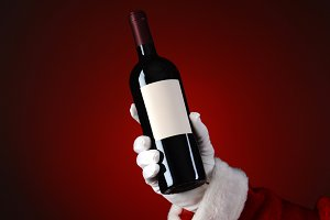 Santa Holding Wine Bottle