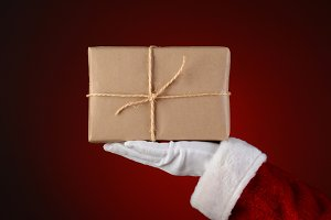 Santa Holding a Parcel in His Palm