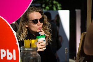 blonde in sunglasses drinking