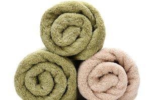 Three Rolled Bath Towels