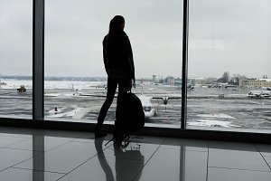 Woman standing in airport terminal