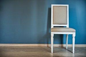 White chair near the blue wall