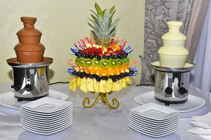 Chocolate fountains with fruits