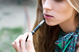 Woman smoking electronic cigarette