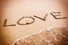 inscription LOVE on the sand