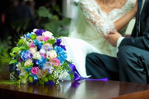 wedding bouquet near bride