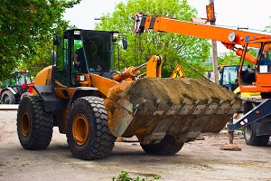 Excavator for road works