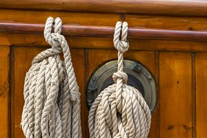 Ropes tied on the deck of an old wooden boat