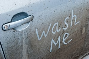 Wash Me Words on a dirty car