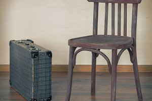 Old chair and an old suitcase