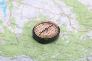 Compass over the topographic map