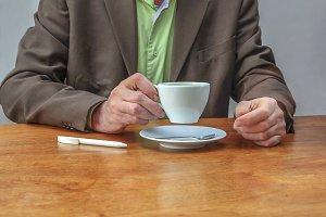 Man at desk drinking coffee