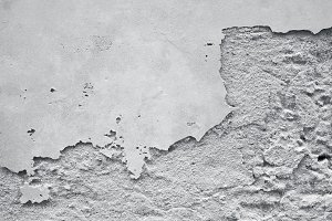 white concrete ement wall with crack