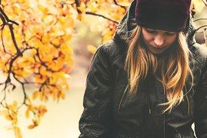 Sad Woman walking in autumn park