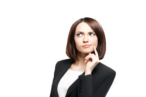 Beautiful thinking business woman isolated