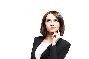 Beautiful thinking business woman isolated