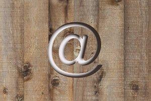 At symbol in wood