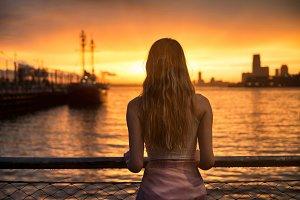 girl standing on ocean pier