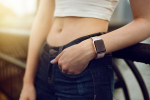 girl with electronic watch