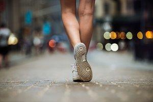 Female feet wearing sneakers