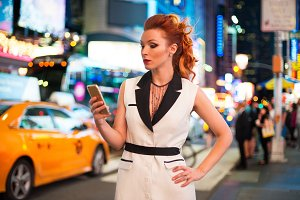 business red haired woman texting