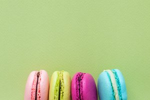 Macaroons on green background