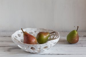 white ceramic colander with pears