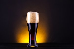 Tall glass of dark beer