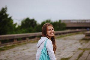 Smiling young girl walks in Tallinn