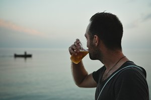 Man Drinking Beer in Sea Beach