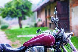 Motorcycle and farmhouse