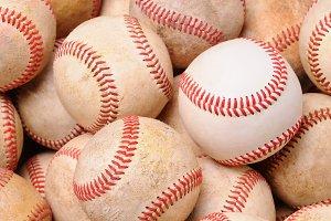 Pile of Old Baseballs One New Ball