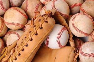 Glove on Pile of Old Baseballs