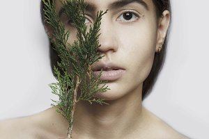 girl with a sprig of juniper