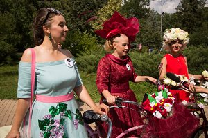 Three ladies on a bicycle