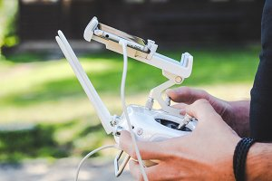 Drone remote control in hands man