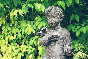 Boy bronze statue