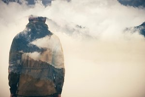 Double Exposure of Man and Cloudy