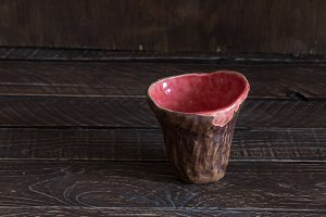 clay cup on a brown background