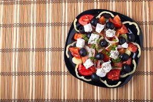 Top view of fresh vegetarian salad
