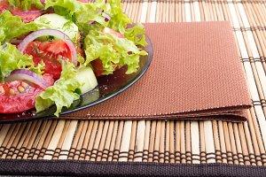 Plate with fresh salad closeup