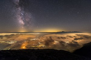 Milky Way over town and mountains
