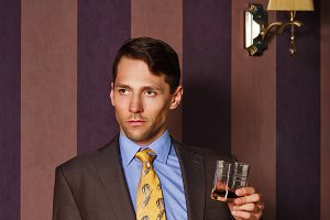 Businessman holding glass of whiskey