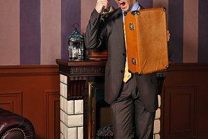 Businessman cursing on phone