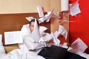 Businessman throws documents