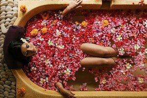 Woman taking flower bath