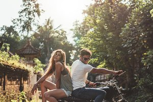 Couple hanging out with motorcycle
