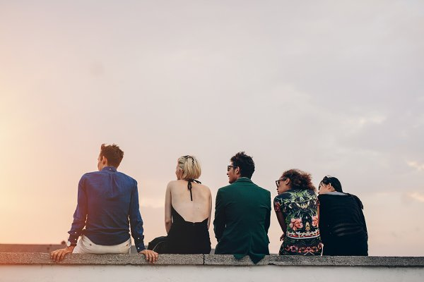 Young people hanging out on rooftop